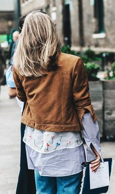 Make tulle work-appropriate by layering it on top of your go-to button-down.... - Street Style