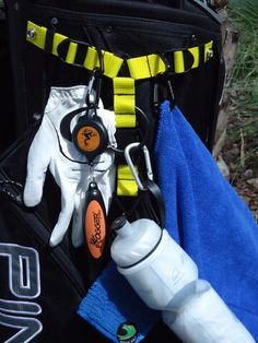Increase the places to hang those needed accessory items on the outside our golf bag. Uses the rain hood snaps and is adjustable to fit all bags. Available at www.snaphookzgolf.com