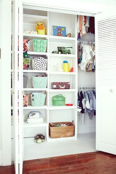 Nursery Closet. Like the mismatched baskets for some extra color