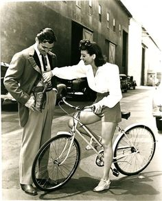 "Joan Crawford (when she was stunning and before she turned into ""Mommy Dearest"") rides a bike and admires Clark Gable's gun."