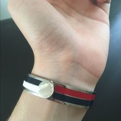 Tommy Hilfiger Bracelet (brand new!) Selling a never worn Tommy Hilfiger bracelet! Decided it isn't my style. Very cute though! Has a stainless steel band enameled with red white & blue, a magnetic closure, and can be worn as a bangle or cuff. Perfect 4th of July accessory! Tommy Hilfiger Jewelry Bracelets