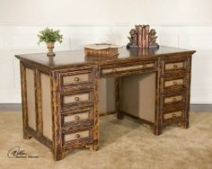 Mango Wood Desk with Dovetail Drawers by Uttermost. $1625.80. Material: MANGO WOOD & MDF. Solid mango wood, with dovetail drawers, recessed panels on all sides, and computer accommodations. Distressed, hand painted finish is creamy pebble with dark cinnamon wood grain accents.. Save 10%!