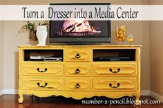 Lighter/softer yellow.  Vintage dresser turned media center.