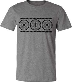 Where would we be without the wheel? This lovely design is simple and understated with three bicycle wheels-representing both the mountain bike and the road bike- and bike chains outlining the design. Perfect for the cyclist!  Love the softness of this tee! Lightweight, 52% combed ringspun cotton/48% polyester super soft tee. This listing is for the HEATHER CARDINAL. Also available in other colors!    HEATHER BROWN…