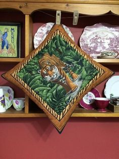 A personal favourite from my Etsy shop https://www.etsy.com/uk/listing/398513857/sale-item-tiger-jungle-pillow-quilted