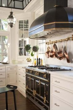 House Beautiful ~ Gorgeous black and white Island Style kitchen ~  McKee Patterson, AIA,