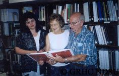 German Library & Museum - Fresno, CA Central California Chapter Library & Museum, American Historical Society of Germans from Russia. (left to right): Lilia Belousova, State Archives, Odessa, Ukraine, Fran Koop Foth and David Foth. David shows family histories in library collection.