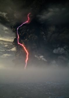 A single lightning bolt climbs the ash cloud of erupting Grímsvötn volcano, Iceland seen from nearby Vatnajökull, on May 22, 2011.