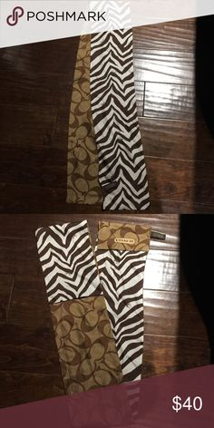 Coach Zebra silk scarf Silk coach scarf! Brown signature C on one side and brown zebra stripe on the opposite side.  Only used once. Great condition!! Coach Accessories Scarves & Wraps