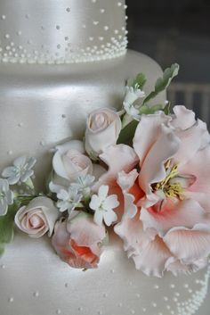 www.sylviaskitchen.co.uk Three tier wedding cake at The George in Rye, Sussex.  Finished with champagne lustering, piped graduated microdots and sugar flowers including full bloom peony, roses, buds, foliage and blossoms.  All three tiers of moist caramel sponge with whipped salted  caramel buttercream.  Cake serves 100 finger portions.