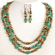 """Beautiful Turquoise glass bead necklace set is a blend of earthy warmth and polish. The Czech glass, crystal and freshwater pearl triple strand closes a 22"""". Come sit by the fire, ON SALE 9/1-14. http://earthandmoondesign.com/shop/beadz-by-roz/bonfire-18-inch-turquoise-glass-bead-necklace-set/"""