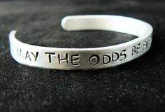 Hunger Games Jewelry hand stamped bracelet  may by StampedWorld
