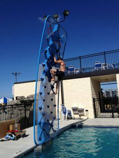 Climber at Prairie Athletic Club taking on the AquaClimb Sport poolside climbing wall.  Do you dare? See more at http://www.facebook.com/aquaclimb or www.aquaclimb.com We want to see you in the next picture.