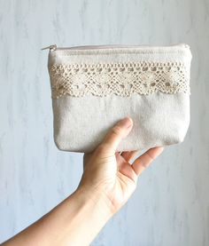 Linen and lace cosmetic bag, zipper pouch, make-up pouch, small clutch. $19.00, via Etsy.