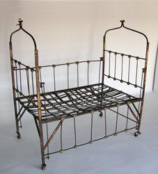#46-240 19th c iron child's bed - Guatemala 46x31.25x51 seat 18