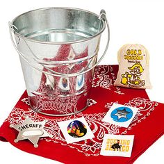 Our Western Favor Pack features a silver metal bucket that may be filled with sheriff and cowboy items. Each Western Favor Tin includes six super hoedown items.