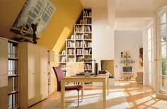 converted *attic* workspace. Incredible light and creative bookshelf-ery.