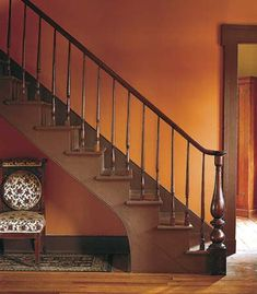 and Cheery Rooms Inspired by Fall Colors Pumpkin-orange walls enhance the rich brown tones of a walnut staircase and its painted treads.Pumpkin-orange walls enhance the rich brown tones of a walnut staircase and its painted treads. Behr Paint Colors, Wall Colors, House Colors, Foyer Colors, Living Room Paint, Living Room Colors, My Living Room, Orange Rooms, Orange Walls