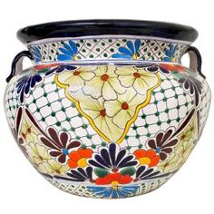 This impressive Talavera Planter embodies all the charm of Mexican Talavera. Featuring intricate floral patterns and classic, multi-colored designs, this striking Talavera Planter will beautify any home or garden. Talavera Pottery, Ceramic Pottery, Pottery Art, Mexican Colors, Mexican Flowers, Mexican Garden, Mexican Folk Art, Decorated Flower Pots, Principles Of Design