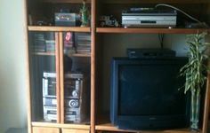 **Oak Wood Center TV/Stereo Unit**Buy Now$100.00