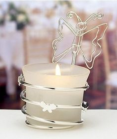 Butterfly wedding place card holders can also be used as favors. Butterfly Wedding Candle Favors features an ivory frosted glass votive, wire base and is adorned with butterflies. Design Candle Holders, Silver Candle Holders, Glass Votive Holders, Butterfly Wedding Theme, Butterfly Party, Butterfly Design, Butterfly Shape, Candle Wedding Favors, Candle Favors