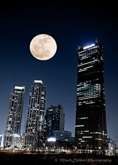 Moon over Kumho and the 63 Building in Seoul