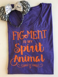Is Figment one of your favs? Me too! This adorable lightweight t shirt is the perfect shirt to wear on your EPCOT adventure! Want this design on a tank? add the tank upgrade listing to the cart along with this listing. Heres the link to the tank upgrade: https://www.etsy.com/listing/508251050/racerback-tank-upgrade?ref=shop_home_active_1 This design is available in the following styles: Purple tee with orange writing White tee with purple writing White tee with...