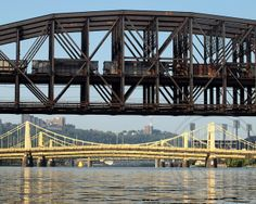 Fort Wayne Railroad Bridge over the Allegheny River, Pittsburgh, Pennsylvania - photo by jag9889, via Flickr;  with the three parallel bridges called The Three Sisters in the distance:  Roberto Clemente, Andy Warhol, and Rachel Carson bridges