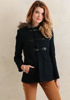 This short coat created in dark, textured navy is sure to keep you warm with its functional hood complete with faux fur trim. Finished with three faux leather strap and notch closures with metal ...