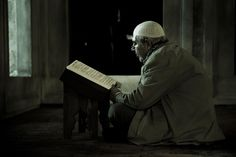 Studying the Quran on dim afternoon light by Vagelis Poulis on 500px