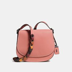saddle 23 with colorblock link strap by COACH. Based on an archival Coach design from the 1970s, the Saddle is both nostalgic and modern. It's crafted in glovetanned leather with a strap featuring our intricately woven Coach Link detail. ; Glovetanned leather Inside zip and open pock... #coach #bags