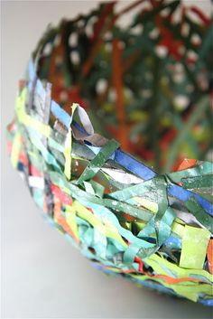 paper mache. This one a 4th grade art project - maybe I could manage it.- magazine paper strips dipped in mache mix and laid over an upside down balloon resting in a cup