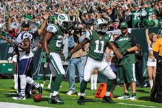 Wide receiver Jeremy Kerley #11 of the New York Jets celebrates after his touchdown catch in the 1st quarter against the New England Patriot...