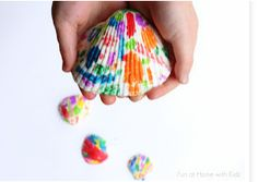 What do you do with those shells when you get home from the beach? Turn them into a fun art project for kids! This is actually a melted crayon project, too, so it's even cooler.