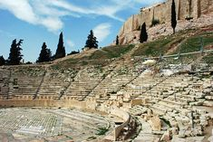 Theatre of Dionysus  built ca. 350 BC  This theatre is located in Athens, Greece, just below the Acropolis, part of which can be seen in the upper right corner of this image. Athenians could gather to enjoy many plays here at the sanctuary dedicated to the god Dionysus. http://www.visit-ancient-greece.com/theatre-of-dionysus.html