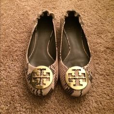 Tory Burch Python Reva Flats Worn only a handful of times, still in great condition. There are a couple of scratches on the front of one of the shoes (as pictured) but it is not noticeable when wearing them. The emblem is gold. Tory Burch Shoes Flats & Loafers