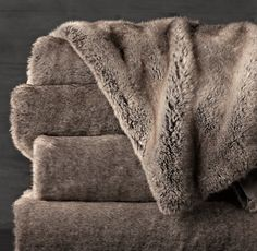 Cozy blankets to snuggle under during a movie. Restoration Hardware, Faux-Fur Throw (Wolf).