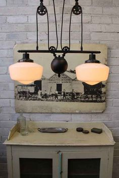 Schoolhouse Double Arm Pulley Light has vintage industrial charm