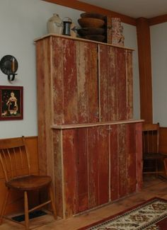 My all-time FAVORITE primitive TV cabinet!!! (from my all-time FAVORITE Picture Trail House!! :-D) Jo and her husband made this from OLD FLOORBOARDS they found when renovating their house!!! Isn't that SO COOL?!?! ALL her PT albums are VERY inspiring!!! :-D