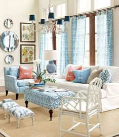 This living room feels fresh and happy thanks to a coral and blue color palette. Home Living Room, Living Room Designs, Living Room Decor, Living Spaces, Dining Room Table, Table And Chairs, Lounge Chairs, Loft Industrial, Colorful Curtains