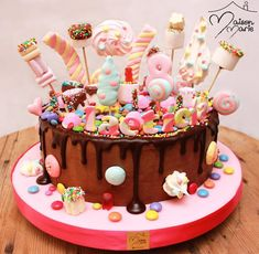 Want to really wow your little one at their next birthday party? Then present them with the showstopping, beyond-cool candy-covered cake of their dreams. You are in the right place about Birthday Cake Torta Candy, Candy Cakes, Easy Cake Decorating, Birthday Cake Decorating, Sweetie Cake, Sweetie Birthday Cake, Lol Birthday Cake, 26 Birthday, Candy Birthday Cakes
