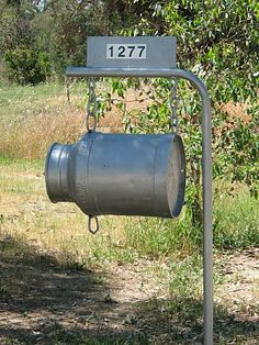 milk can mailbox - Can I say target for batting practice on a country road...  Easy way to tell people where the drive is.. Lol