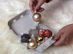 Tip #5: Eggsellent storage idea: Egg cartons protect small round ornaments and can also be very convenient catch-alls for those tiny ornament hooks. | 7 Clever Ways to Store Christmas Decorations with Upcycled Items >>http://www.diynetwork.com/decorating/7-clever-ways-to-store-christmas-decorations-with-upcycled-items/pictures/index.html?soc=pinterest