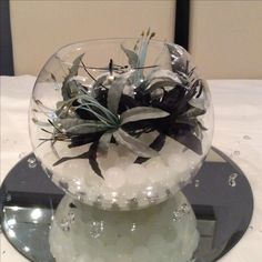 Fish bowl wedding centrepiece for black and grey themed weddings. Available to hire for your wedding in Swansea, Neath, port talbot, Bridgend, porthcawl, Llanelli, Carmarthen and surrounding areas of South Wales from affinity event decorators www.affinityeventdecorators.com