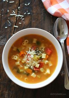 Minestrone soup with tomatoes, white beans, vegetables and pasta.
