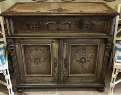 """Charming one-of-a-kind buffet or hall chest artisan made from reclaimed wood. You'll love the hand carved details, and artist applied stencils and heirloom patina. Finished with craquelure for a charming aged look. 42"""" x 20.25"""" x 38"""" tall."""