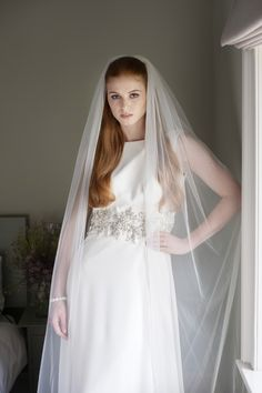 Flame...  A striking single tier train length veil in Italian tulle finished with gleaming diamanté edging and comb.