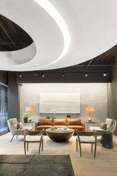 Douglas Elliman Makes a Grand Entrance Onto the L.A. Scene with its Patrick Tighe-Designed Office | Custom steel side tables stand in the lounge.