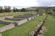 Ruins of soldiers' barracks at Chesters Roman Fort, along Hadrian's Wall in England.  The wall was a defensive fortification in Roman Britain. Begun in AD 122, during the rule of emperor Hadrian, it was the first of two fortifications built across Great Britain.