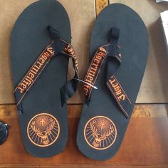 """Jagermeister flip flops New Jagermeister unisex flip flops. Size marked is Large, measures about 12"""" long. I do not know what numbered size this corresponds to, please know your length measurement in flip flops. Jagermeister Shoes Slippers"""